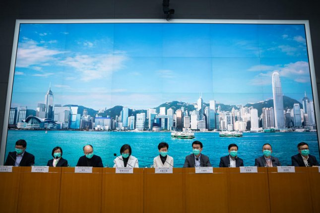 Hong Kong Chief Executive Carrie Lam (center) announces travel restrictions Tuesday in a bid to halt the coronavirus outbreak. Photo by Jerome Favre/EPA-EFE
