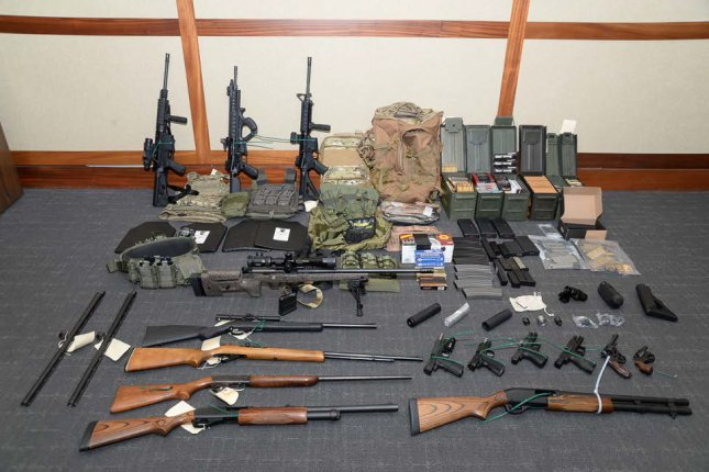 A cache of weapons and accessories found in Christopher Paul Hasson's apartment following his arrest. Photo courtesy U.S. Attorney's Office for the District of Maryland