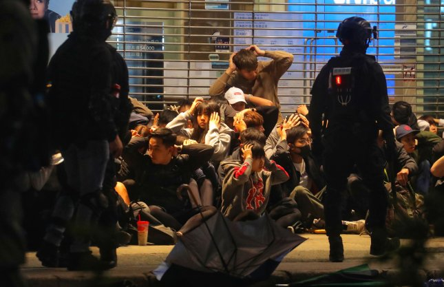 Riot police detain protesters during an anti-government rally on New Year's day in Hong Kong, China. Photo by Vivek Prakash/EPA-EFE