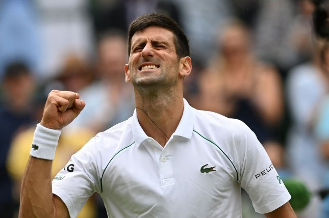 Novak Djokovic of Serbia celebrates after winning his fourth-round match against Cristian Garin of Chile at the Wimbledon Championships on Monday in London. Photo by Neil Hall/EPA-EFE