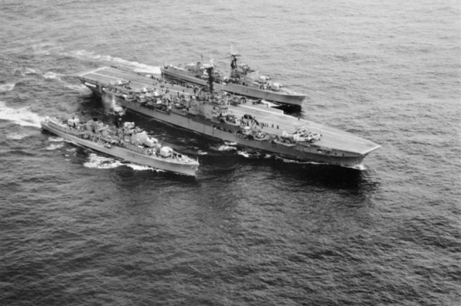 Aerial starboard side view of the Royal Australian Navy aircraft carrier HMAS Melbourne (R21) and the destroyers HMAS Vendetta (D08) and HMAS Voyager (D04) underway, circa in 1959. On February 10, 1964, 82 Australian sailors died when the Melbourne and the Voyager collided off New South Wales, Australia. File Photo courtesy of the Australian armed forces
