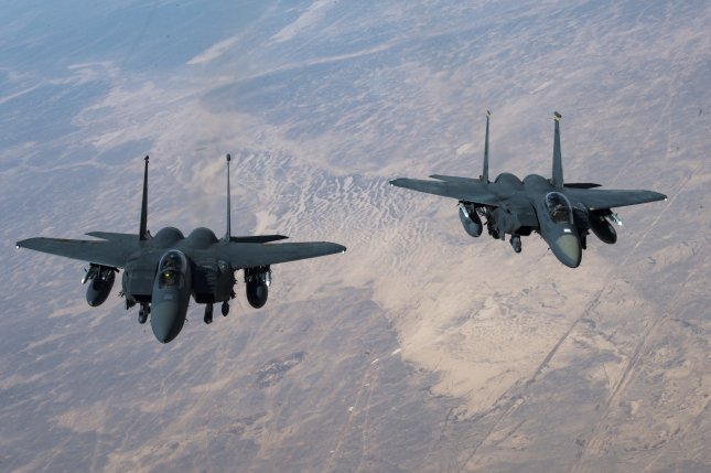 The U.S. military fired seven precision-guided munitions from two F-15E Strike Eagles, similar to the ones pictured, in airstrikes on Iranian-backed targets in Syria. File Photo by Staff Sgt. Matthew Lotz/U.S. Air Force