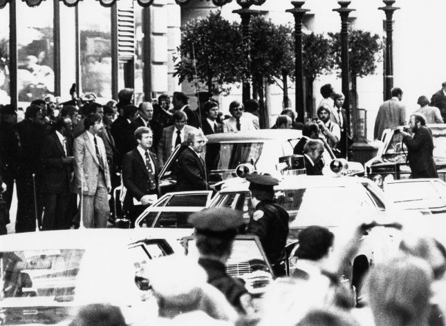 Reaction of Secret Service agents, police, and bystanders approximately one second after Sara Jane Moore attempted to assassinate President Gerald R. Ford on September 22, 1975, in San Francisco. Photo courtesy Gerald R. Ford Library