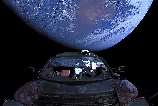 spacex starman travels toward asteroid belt in tesla roadster