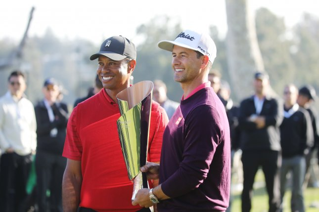 Australian golfer Adam Scott (R) was 11-under par, while Tiger Woods (L) was 11-over par during the 2020 Genesis Invitational at Riviera County Club in Los Angeles. Photo by David Swanson/EPA-EFE