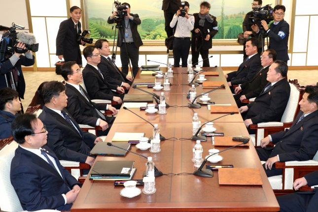 South Korean delegates (L) and their North Korean counterparts hold high-level talks at the border village of Panmunjom, North Korea, on Tuesday. Photo by EPA-EFE