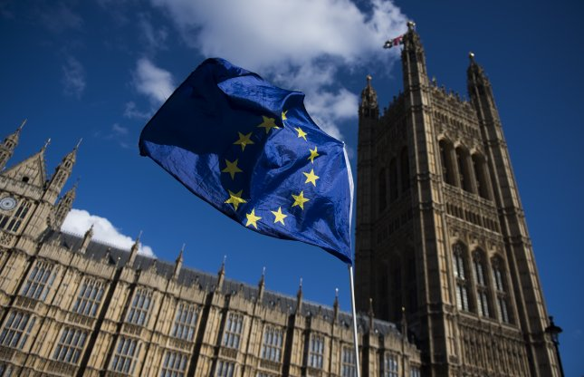 An E.U. flag flown by a protester next to the Houses of Parliament in London on September 22. On Thursday, the EU Parliament voted to conduct a study on whether they should keep turning clocks forward for daylight savings time. File Photo by Will Oliver/EPA-EFE