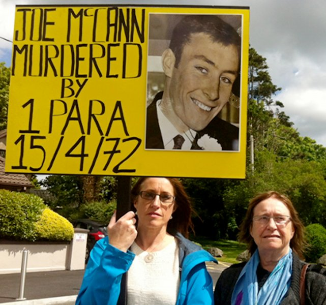 Aine McCann (L) and her mother, Anne McCann (R), widow of official IRA leader Joe McCann, hold up a placard during their protest against Britain's Prince Charles' visit to Galway, Ireland, on May 19, 2015. A Belfast court on Tuesday acquitted two British army veterans of Joe McCann's murder. File Photo by Stringer/EPA