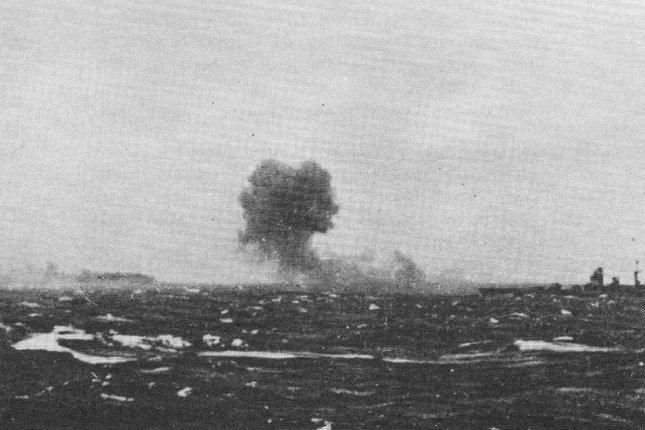 Smoke rises from the German battleship Bismarck shortly before it sinks May 27, 1941. File Photo courtesy of the Royal Navy