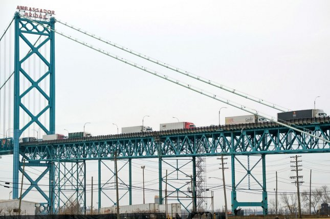 Trucks cross over the Ambassador Bridge to the U.S. side of the U.S.-Canadian border in Detroit, Mich., on March 18, 2020. File Photo by Steve Fecht/EPA-EFE