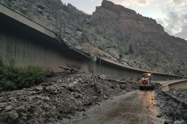 Crews work to remove debris caused by flash floods and mudslides in Colorado. Photo by Colorado Department of Transportation