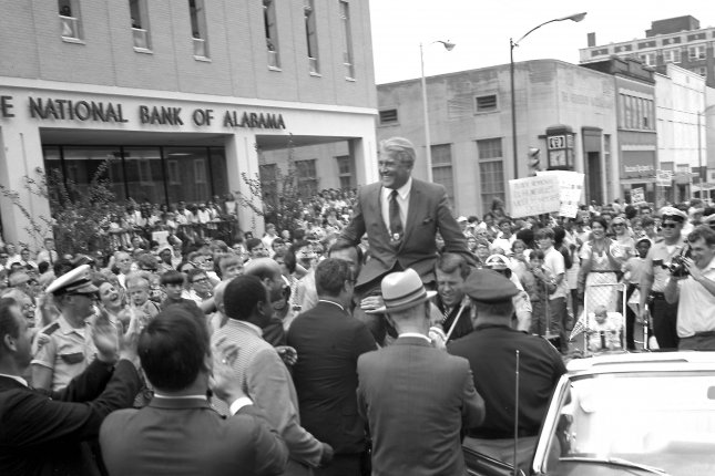 Dr. Wernher von Braun, director of NASA's Marshall Space Flight Center in Huntsville, Alabama, is carried aloft on the shoulders of city officials during the Apollo 11 celebration in downtown Huntsville on July 24, 1969. File Photo by NASA/UPI