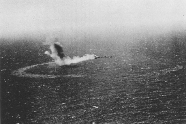 The U.S. Navy fleet oiler USS Neosho burns and slowly sinks after an attack by Imperial Japanese Navy dive bombers on May 7, 1942, during the Battle of the Coral Sea. File Photo courtesy of Wikimedia
