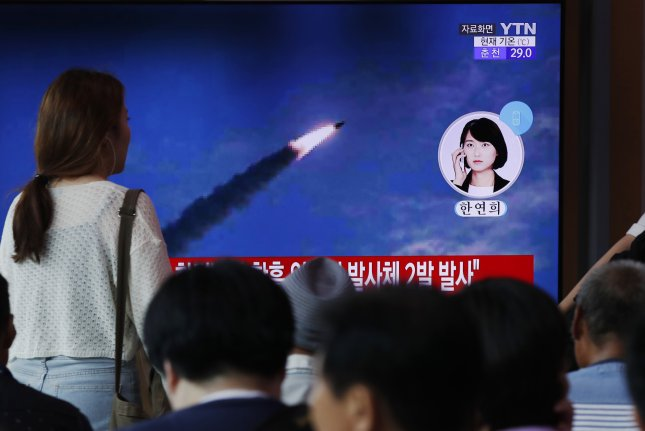 South Koreans watch breaking news reports of North Korea's missile launch on August 10. North Korea launched two more unidentified projectiles on Thursday from an area near the capital of Pyongyang, into the sea off its east coast. File Photo by Jeon Heon-Kyun/EPA-EFE