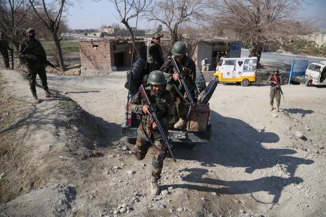Afghan Army soldiers patrol at a check point near the Shirzad district, in Hogyani district of Nangarhar province, Afghanistan, on Sunday. Twi American soldiers were killed and six wounded by someone wearing an Afghan soldier's uniform. Photo by Ghulamullah Habibi/EPA-EFE