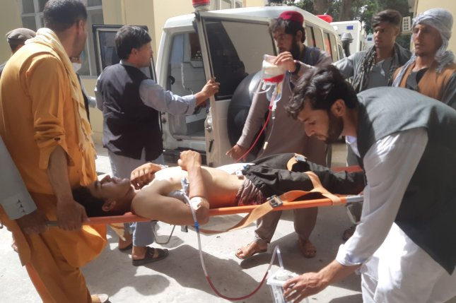 A HALO Trust worker is moved to an ambulance on Wednesday following an attack in Baghlan, Afghanistan, on Wednesday. Photo by Ajmal Omari/EPA-EFE