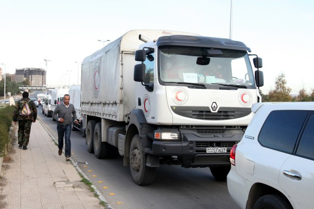 Trucks with relief goods head to the besieged Madaya and al-Zabadani towns in the countryside of Damascus, Syria, on February 17, 2016. China and Russia are attempting to reduce the number of cross-border locations to transport aid into Syria. File Photo by Youssef Badawi/EPA