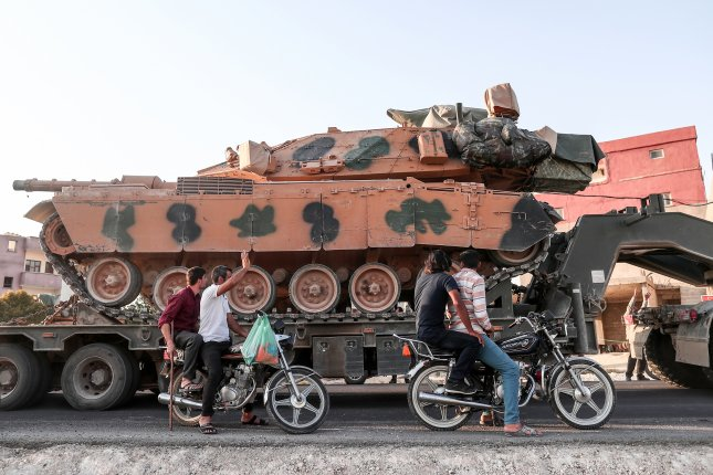 A Turkish military truck carries tanks on the way to Northern Syria for a military operation in Kurdish areas in Akcakale district in Sanliurfa, Turkey, on Sunday. Turkey has launched an offensive targeting Kurdish forces in north-eastern Syria, days after the United States began withdrawing troops from the nation. Photo by Sedat Suna/EPA-EFE