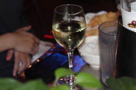 A glass of white wine served at a nighttime dinner in Washington, DC. (UPI/Billie Jean Shaw)