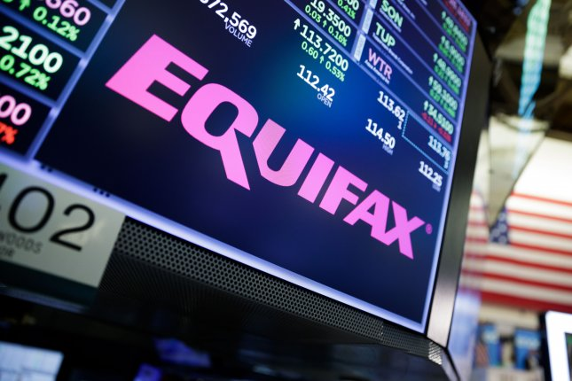 A sign for the company Equifax appears on the floor of the New York Stock Exchange on September 12, 2017, after the credit reporting agency reported a massive breach. The hacking was more widespread than originally disclosed, according to new documents submitted to a U.S. Senate committee. Photo by Justin Lane/EPA