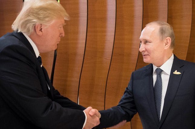 President Donald Trump shakes hands with Russian President Vladimir Putin during the G20 summit in Hamburg, Germany, on July 7, 2017. File Photo by Steffen Kugler/EPA-EFE