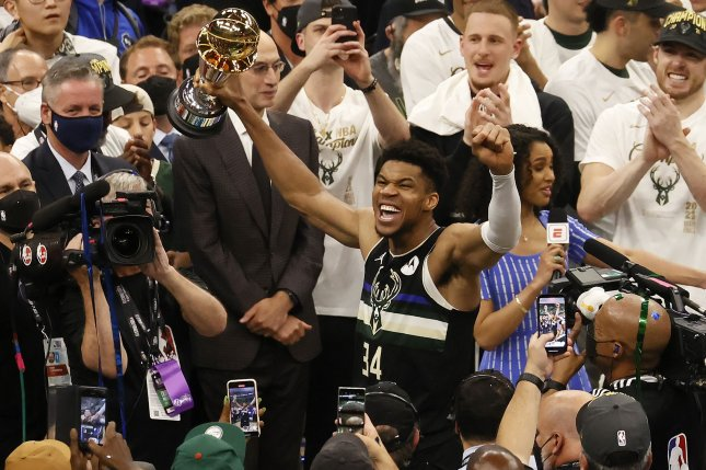 Milwaukee Bucks forward Giannis Antetokounmpo (34) celebrates with the MVP trophy at the conclusion of Game 6 in the 2021 NBA Finals on Tuesday at Fiserv Forum in Milwaukee. Photo by Tannen Maury/EPA-EFE