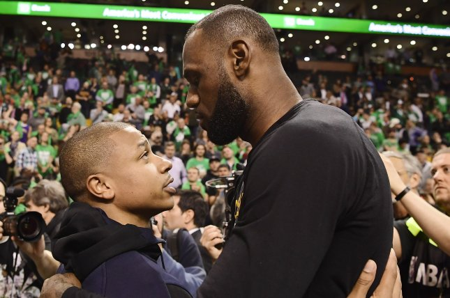 Cleveland Cavaliers forward LeBron James (R) hugs current Cavaliers guard Isaiah Thomas (L) following the Cleveland Cavaliers' victory against the Boston Celtics in the NBA Eastern Conference Finals on May 25 at the TD Garden in Boston, Mass. File photo by John Cetrino/EPA