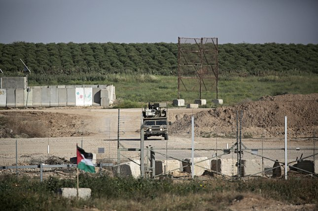 A Palestinian flag is seen near the border next Israeli troops during clashes with Israeli troops along the border between Israel and Gaza Strip in the eastern Gaza Strip on Saturday. On Friday, 15 Palestinians were killed during the clashes along the border with Israel. Photo by Mohammed Saber/EPA