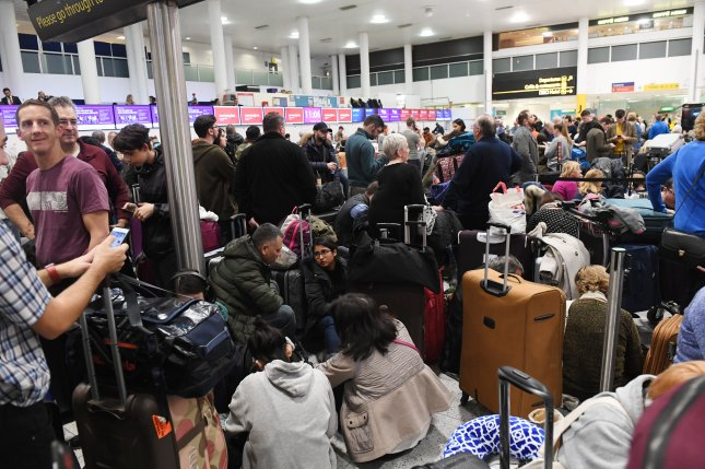 Passengers wait at London's Gatwick Airport, which closed on Wednesday after drone sightings at the airport. After it reopened, another drone sighting forced its closure again on Friday. Photo by Facundo Arrizabalaga/EPA