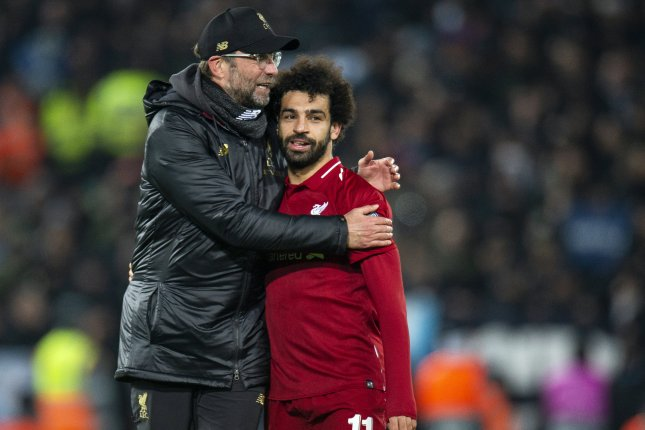 Liverpool's head coach Jurgen Klopp (L) is expected to keep star players like Mohamed Salah (R) in the Reds' lineup for a clash against Manchester City Thursday in Manchester, England. Photo by Peter Powell/EPA-EFE