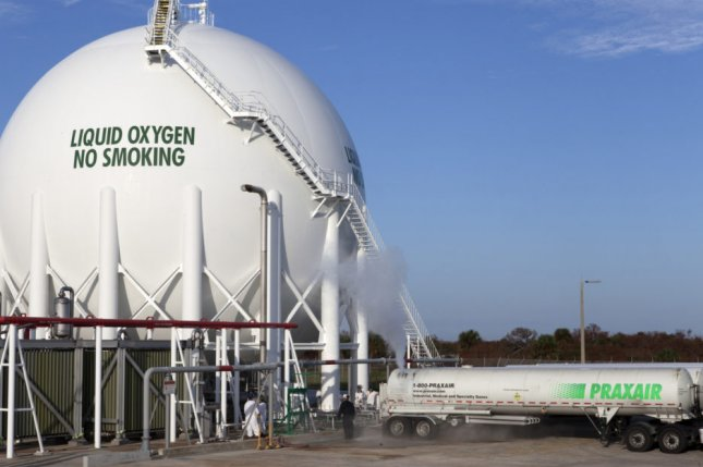Trucks offload liquid oxygen at a storage tank inside Kennedy Space Center in Florida. Photo courtesy of NASA
