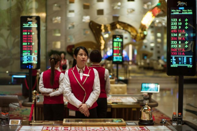 Dealers are seen on the gaming floor of the MGM Cotai casino in Macao, China. File Photo by Jerome Favre/EPA-EFE
