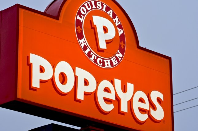 The sign outside a Popeyes Louisiana Kitchen restaurant. Photo by Jeramey Lende/Shutterstock.com