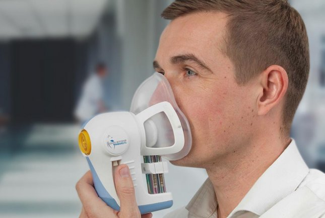 A person uses the Breath Biopsy ReCIVA Breath Sampler, a device currently undergoing clinical trial in the U.K. for detection of cancer. Photo courtesy of Owlstone Medical