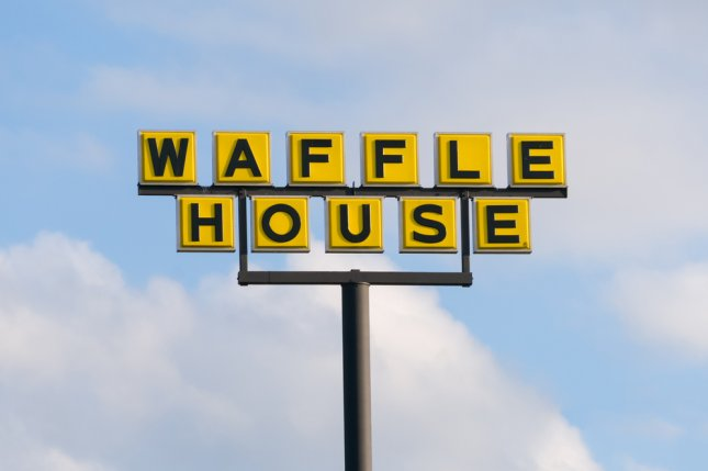 Waffle House exterior sign and logo in Moore, Okla. taken on May 20, 2016. Waffle House, Inc., is a restaurant chain with more than 2,100 locations in 25 states in the United States. Photo by Ken Wolter/Shutterstock