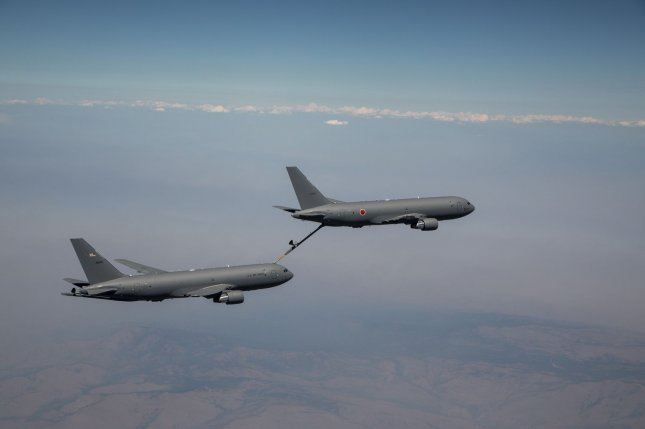 The first KC-46A constructed for Japan recently refueled another KC-46A -- it's first time both giving and receiving fuel during flight -- its manufacturer, Boeing, announced on Monday. Photo by Kevin Flynn/Boeing