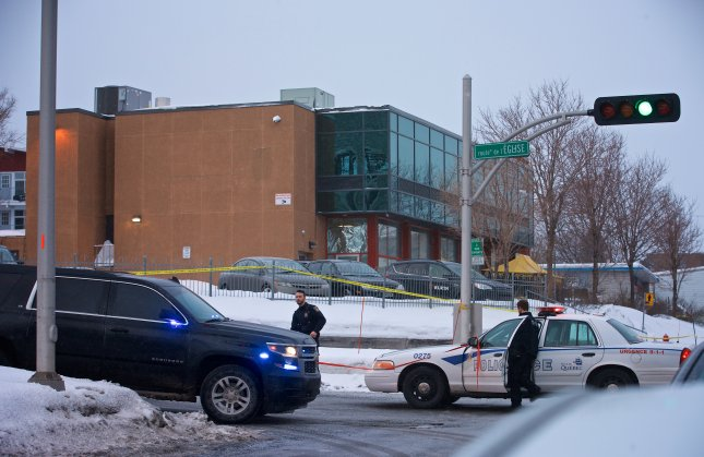 Municipal police patrol outside a Quebec mosque the morning after two gunmen opened fire during evening prayers on January 29, killing six people. File Photo by Andre Pichette/EPA