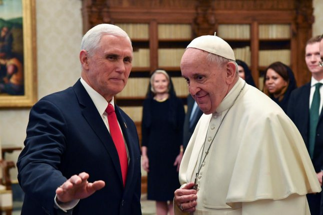 Pope Francis meets Friday with U.S. Vice President Mike Pence at the Vatican, during which the two exchanged gifts. Photo by Alessandro Di Meo/Pool/EPA-EFE