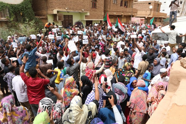 Sudanese protesters shout slogans during a protest against the ruling military council in Khartoum, Sudan, Sunday. Photo by Marwan Ali/EPA-EFE