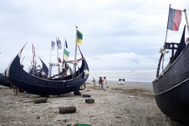 Fishing boats are seen on the sea side of Inani Beach in Ukhia, Cox's Bazar district, Bangladesh. Rohingya refugees who live in overcrowded refugee camps in Bangladesh are risking their lives to cross the Bay of Bengal and the Andaman Sea in search of a better life. File Photo by EPA-EFE