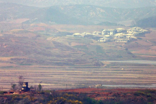The North Korean side of the border as seen from Paju, a South Korean border city north of Seoul. North Korea flooded a shared river Monday and again on Tuesday, prompting a response from South Korea's unification ministry. Photo by Yonhap/UPI