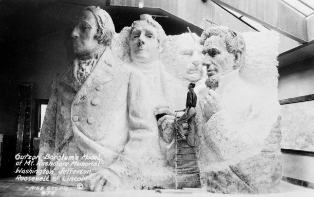 Sculptor Gutzon Borglum in his studio with his model of the Mount Rushmore Memorial, depicting George Washington, Thomas Jefferson, Theodore Roosevelt and Abraham Lincoln. Picture taken circa 1936. File Photo by Library of Congress/UPI
