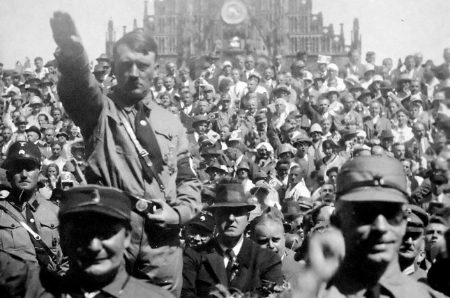 Adolf Hitler attending a Nazi party rally in Nuremberg, Germany, circa 1928. On June 14, 1940, German troops marched down Paris' Champs-Élysées as Allied forces abandoned the French capital. File Photo by NARA/UPI