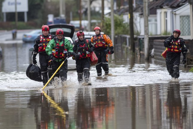 Emergency personnel search a flooded area of Nantgarw village, near Cardiff, South Wales, Britain, on Sunday. Photo by Neil Munns/EPA EFE