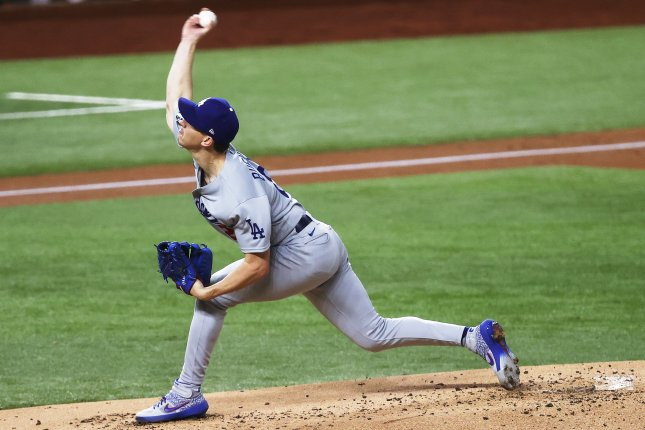 Los Angeles Dodgers pitcher Walker Buehler throws against the Tampa Bay Rays during the first inning in Game 3 of the World Series on Friday night at Globe Life Field in Arlington, Texas. Photo by John G. Mabanglo/EPA-EFE