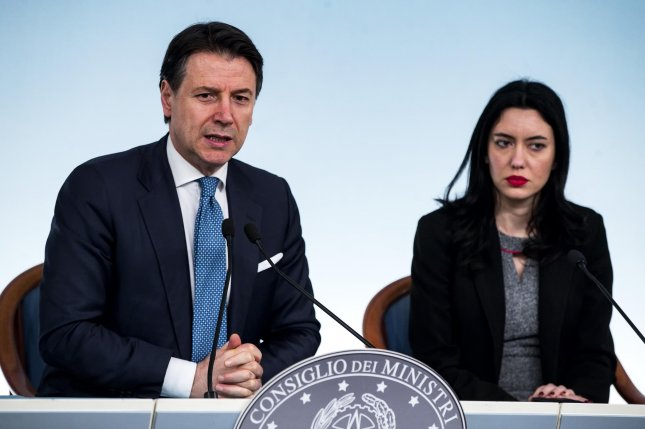 Italian Prime Minister Giuseppe Conte (L) and Italian Education Minister Lucia Azzolina conduct a news conference about Italy's coronavirus emergency situation at the Chigi Palace in Rome on Wednesday. Photo by Angelo Carconi/EPA-EFE