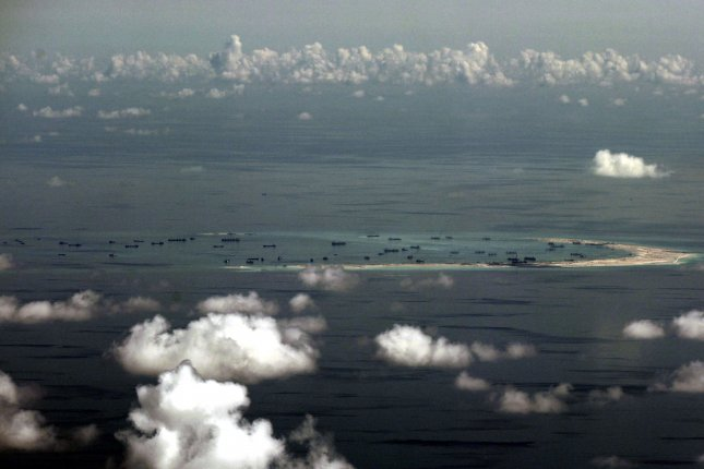 A file picture dated May 11, 2015, shows an areal view of alleged artificial islands built by China in disputed waters in the South China Sea, west of Palawan, Philippines. Photo by Ritchie B. Tongo/EPA