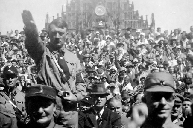 On March 15, 1939, German troops, occupying the Czech provinces in the name of Adolf Hitler, entered Prague in triumph to the hisses and catcalls of the people, who sang the Czech national anthem. File Photo by NARA/UPI