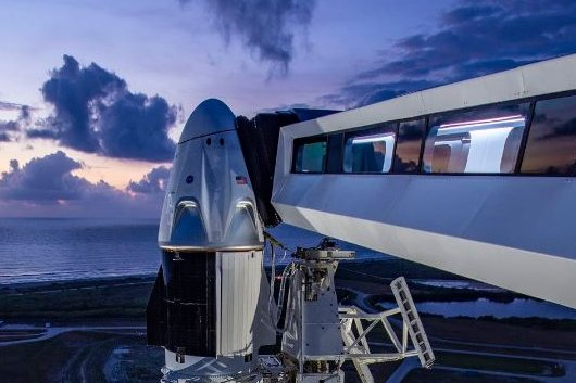 The astronaut walkway is extended to SpaceX's Crew Dragon space capsule atop a Falcon 9 rocket to prepare for liftoff Wednesday from Kennedy Space Center in Florida. Photo courtesy of SpaceX