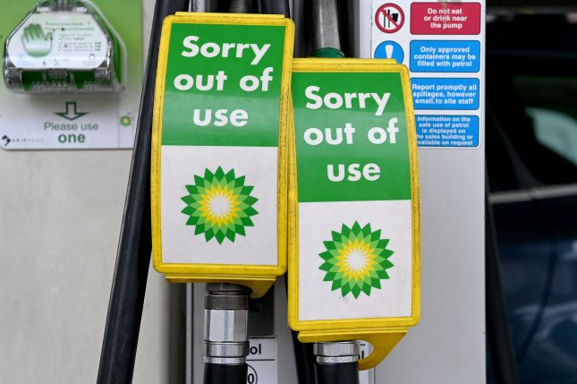 Empty pumps are seen at a BP station in London, Britain, on Friday.Officials said Britain has plenty of fuel in reserves and at refineries, but sporadic panic buying and supply chain disruptions are causing some stations to run out in certain areas. Photo by Facundo Arrizabalaga/EPA-EFE